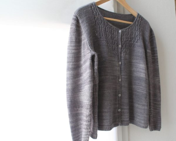 Display of a Trellis cardigan, knitting pattern designed by Julie Partie