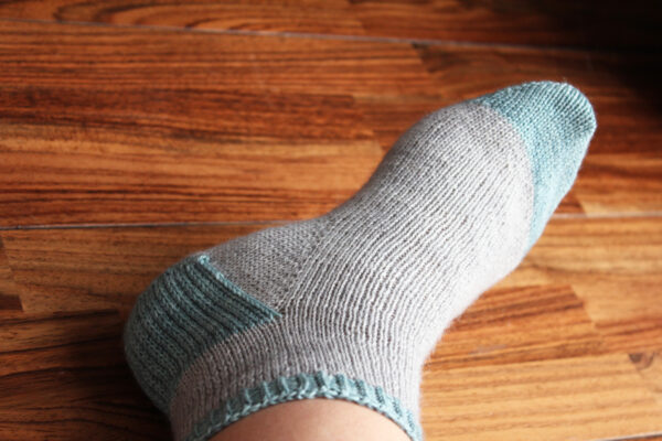 Display of the Suzette socks, a detailed tutorial for beginning sock knitters by Julie Partie