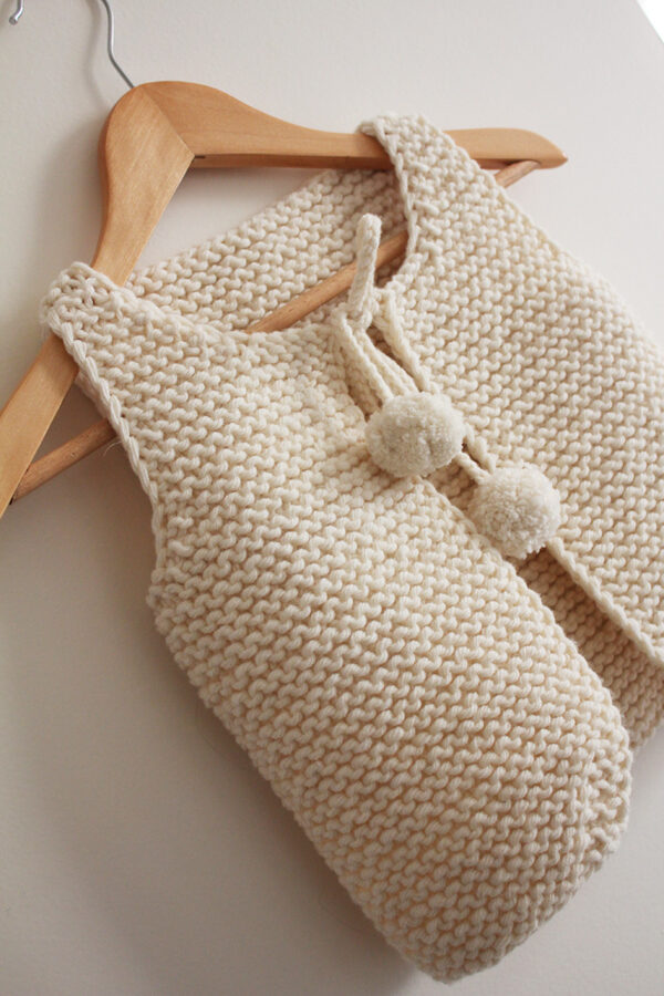 Display of the Lil Shepherd vest, knitting pattern designed by Julie Partie