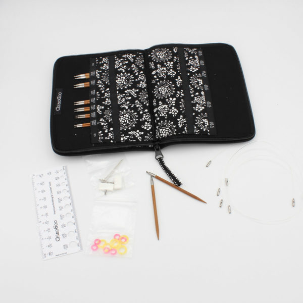 ChiaoGoo SPIN interchangeable needle set presented in its open case, complete with gauge, markers and cables