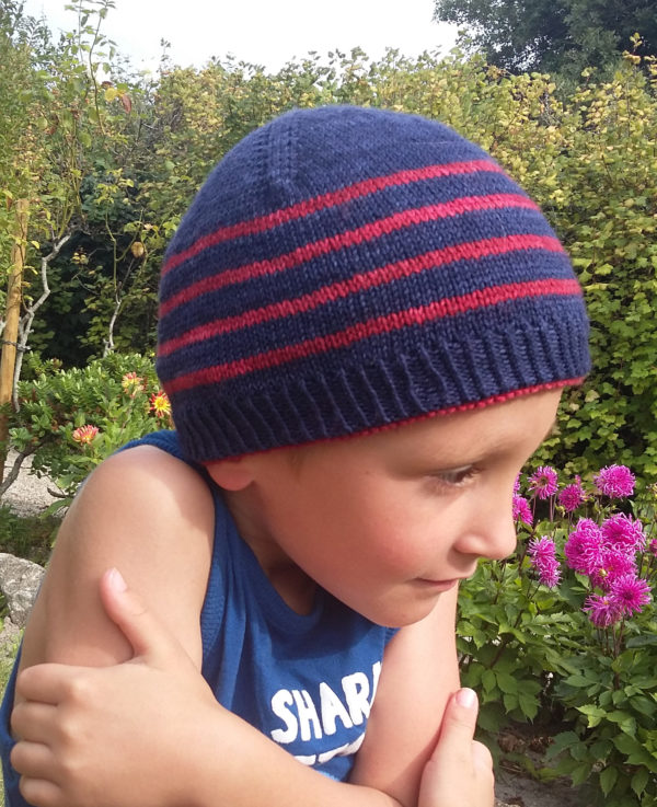 Display of the striped side of the reversible Winter in August hat, a knitting pattern designed by Julie Partie