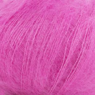 Zoom on a ball of Silky Kid by Kremke Soul Wool in the Fuschia colorway