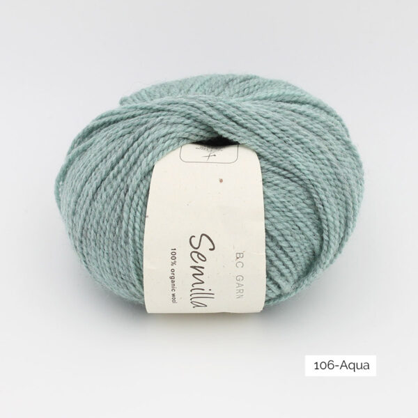 A ball of BC Garn Semilla, in the Aqua colorway (light heathered turquoise)
