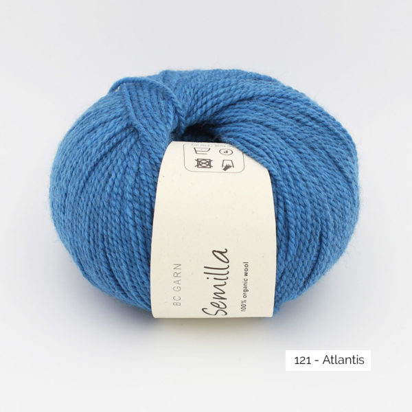 A ball of BC Garn Semilla, in the Atlantis colorway (deep sky blue)