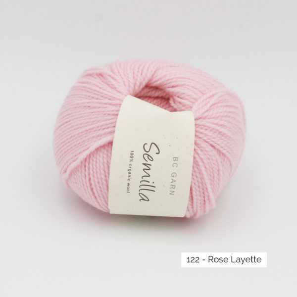 A ball of BC Garn Semilla, in the Rose Layette colorway (baby pink)