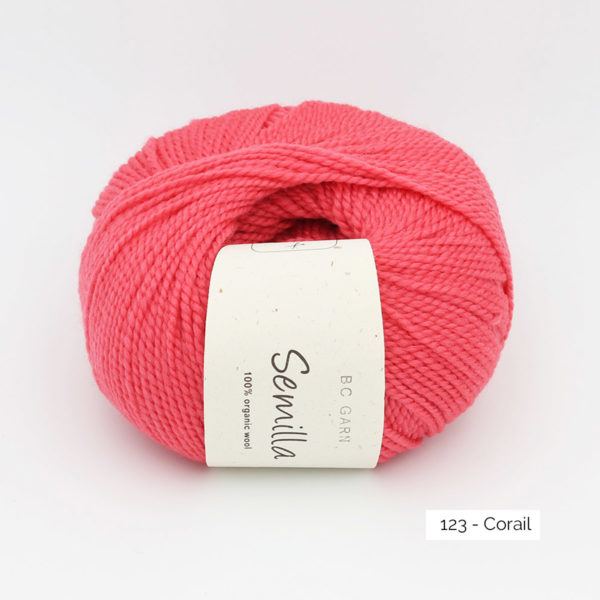 A ball of BC Garn Semilla, in the Corail colorway (coral pink)