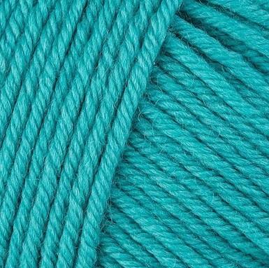 Gros plan sur une pelote de Semilla Grosso de BC Garn coloris 131 (turquoise)
