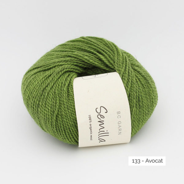A ball of BC Garn Semilla, in the Avocat colorway (heathered moss green)