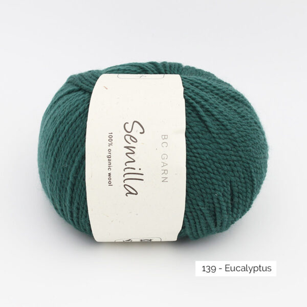 A ball of BC Garn Semilla, in the Eucalyptus colorway (bottle green)