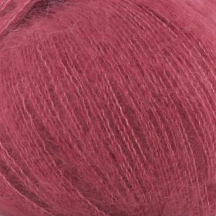 Zoom on a ball of Silky Kid by Kremke Soul Wool in the Amarante colorway (dark purplish red)
