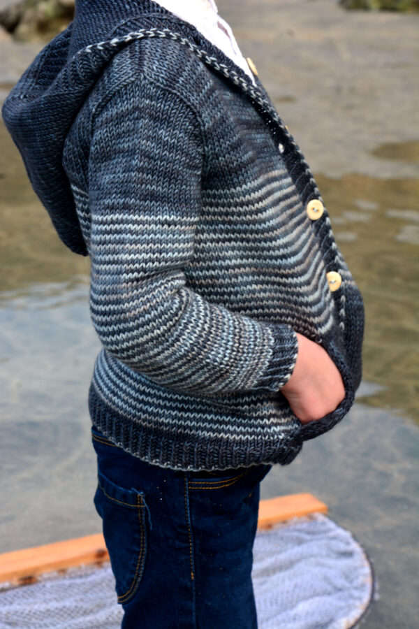 Display of the Malo cardigan by Julie Partie, a knitting pattern for a children's cardigan with stripes, pockets and hood