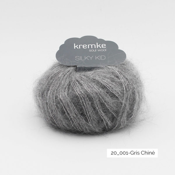 A ball of Silky Kid by Kremke Soul Wool in the Gris Chiné colorway (heathered medium grey)