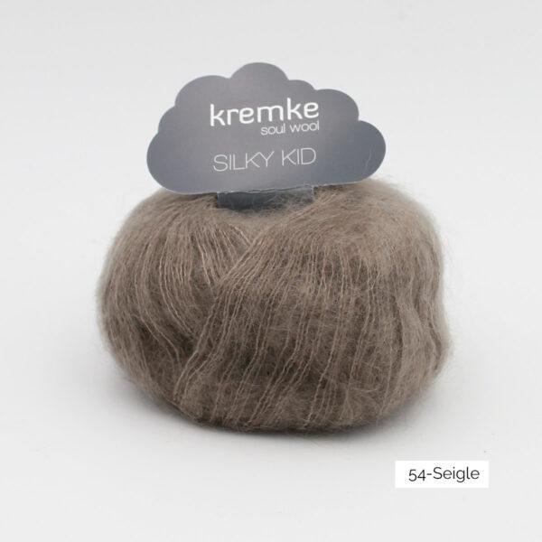 A ball of Silky Kid by Kremke Soul Wool in the Seigle colorway (greyish dark beige)