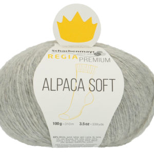 A ball of Regia's Alpaca Soft in the Gris Clair colorway (light grey)