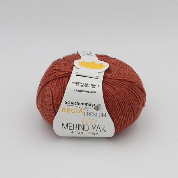 A ball of Regia's Premium Merino Yak in the Brique colorway (brick)