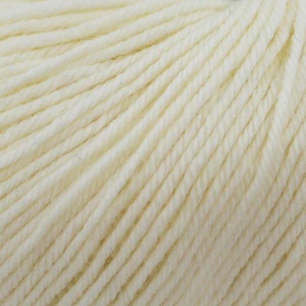 Zoom on a ball of Kremke Soul Wool's Bébé Soft Wash in the Naturel colorway (off white)