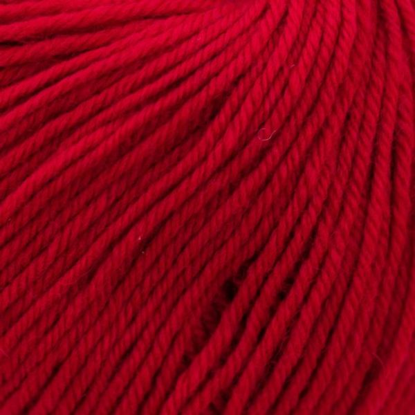 Zoom on a ball of Kremke Soul Wool's Bébé Soft Wash in the Rouge Cerise colorway (cherry red)