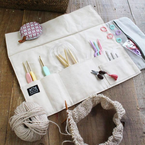 Display of the inside compartments of a Cohana's Mikawa Momen notions pouch, made of natural fabric,