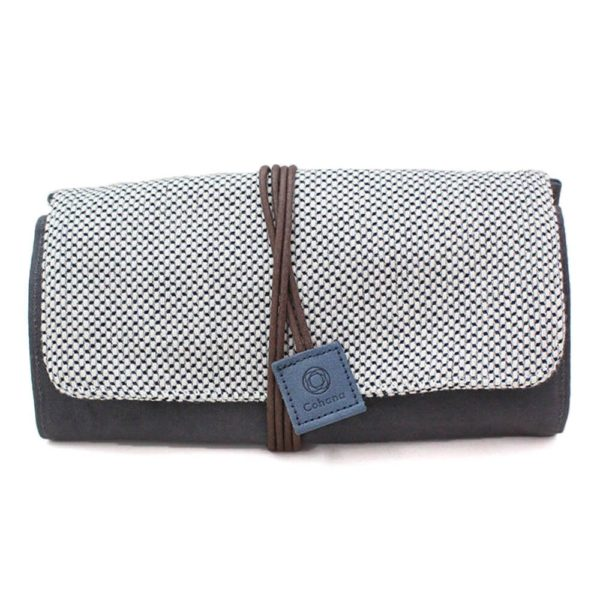 Mikawa Momen notions pouch by Cohana, made of patterned and solid grey fabric, closed with a brown strap with a blue tag