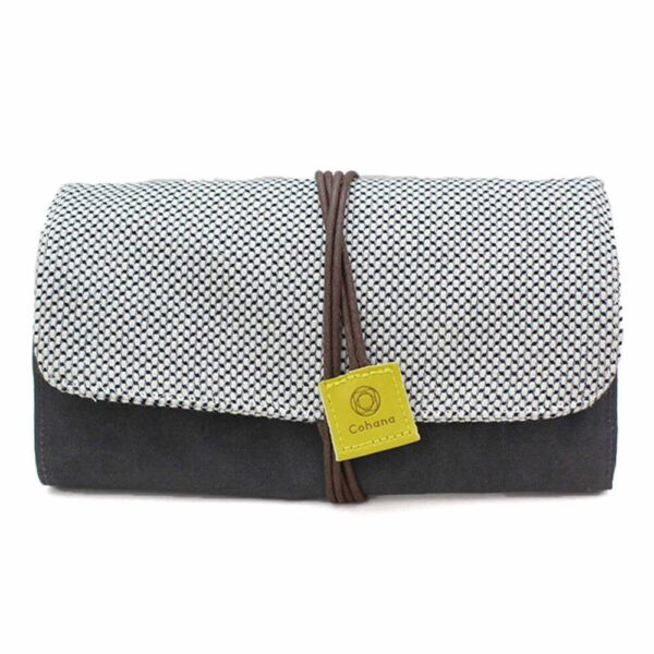 Mikawa Momen notions pouch by Cohana, made of patterned and solid grey fabric, closed with a brown strap with a yellow tag