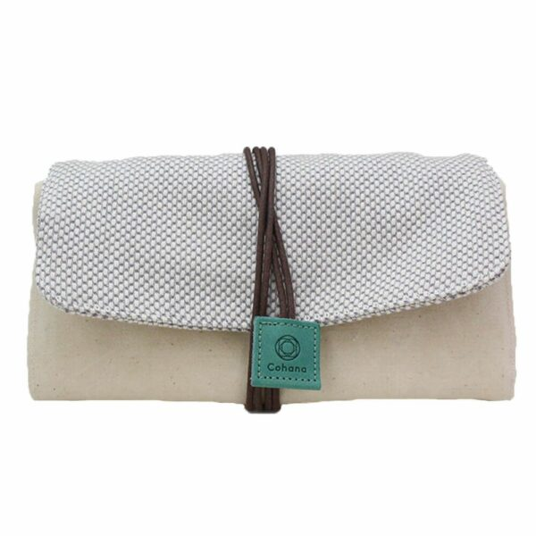 Mikawa Momen notions pouch by Cohana, made of a natural coloured fabric, closed with a brown strap with a green tag