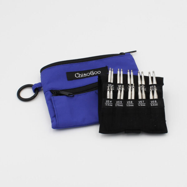 Set of mini-circular interchangeable Chiaogoo Shorties needles, with the tips organized in their sleeve and a blue nylon case in the background
