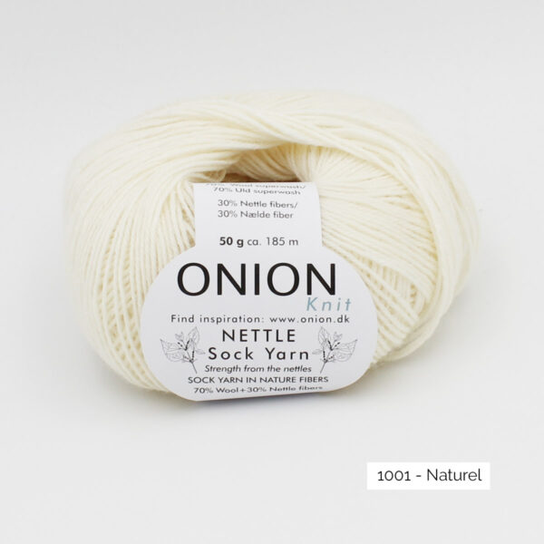 A ball of Onion's Nettle Sock Yarn d'Onion in the Naturel colorway (off white)