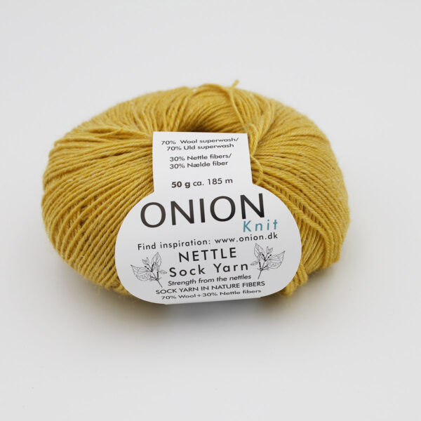 A ball of Onion's Nettle Sock Yarn d'Onion in the Curry colorway