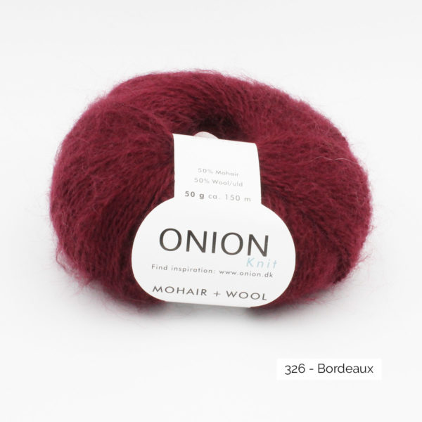 A ball of Onion Mohair + Wool in the Bordeaux colorway (burgundy)