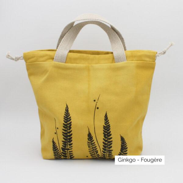 Présentation d'un sac à projet Kaliko, coloris Gingko et imprimé Fougère