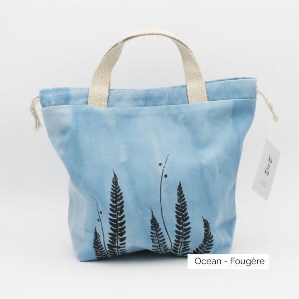 Présentation d'un sac à projet Kaliko, coloris Océan et imprimé Fougère