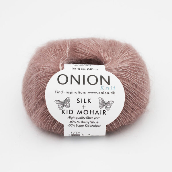 A ball of Onion's Silk + Kid Mohair in the Poudre colorway (light cocoa powder)