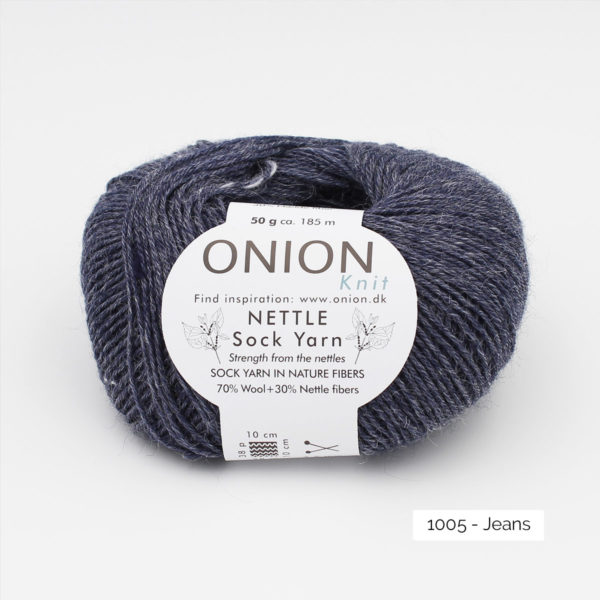 A ball of Onion's Nettle Sock Yarn d'Onion in the Jeans colorway