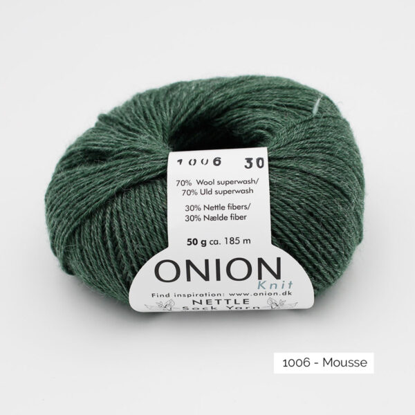 A ball of Onion's Nettle Sock Yarn d'Onion in the Mousse colorway (dark moss green)