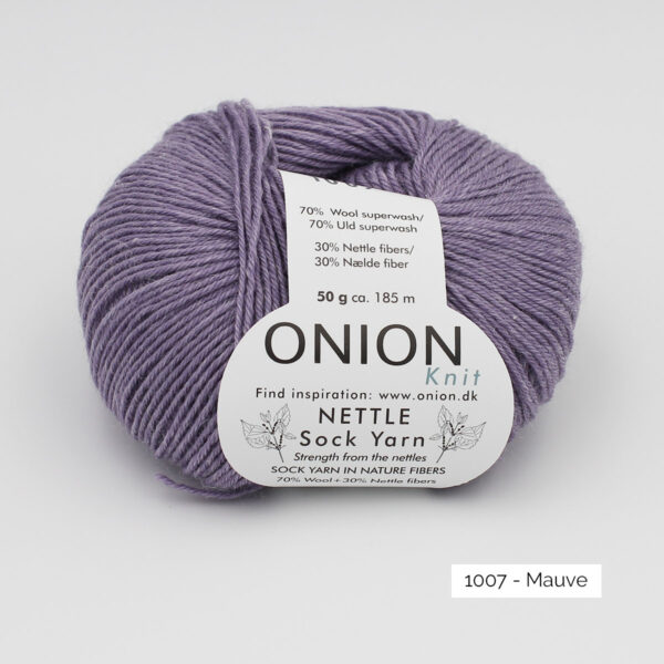 A ball of Onion's Nettle Sock Yarn d'Onion in the Mauve colorway