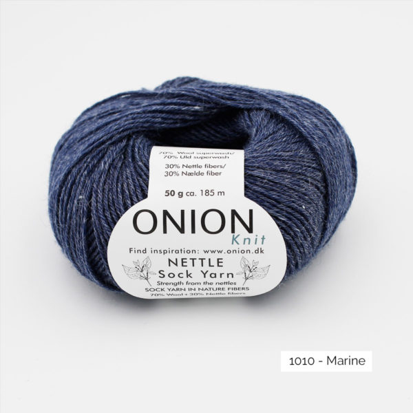 A ball of Onion's Nettle Sock Yarn d'Onion in the Marine colorway (navy)
