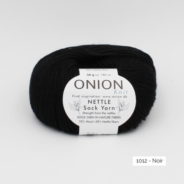 A ball of Onion's Nettle Sock Yarn d'Onion in the Noir colorway (black)