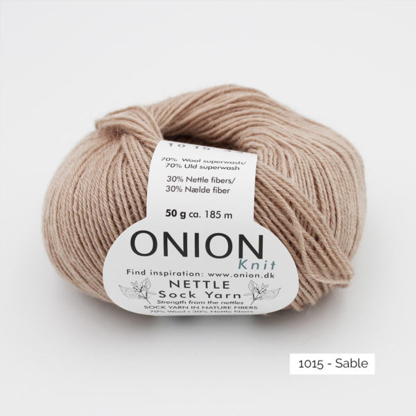 A ball of Onion's Nettle Sock Yarn d'Onion in the Sable colorway (sand)