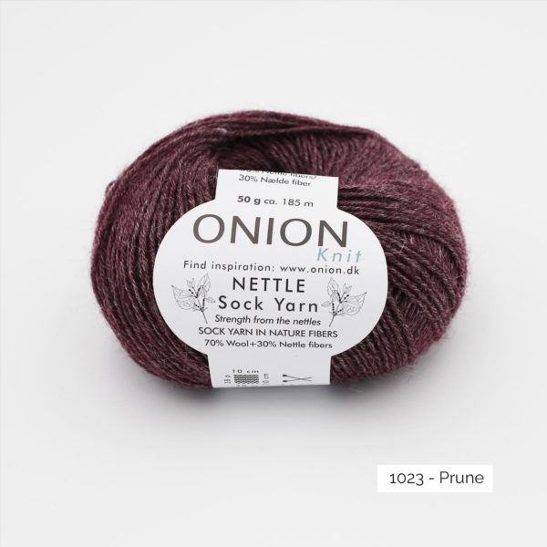 A ball of Onion's Nettle Sock Yarn d'Onion in the Prune colorway (plum)