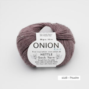 A ball of Onion's Nettle Sock Yarn d'Onion in the Poudre colorway (cocoa powder)