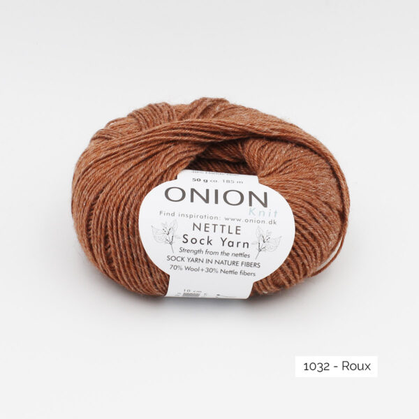 A ball of Onion's Nettle Sock Yarn d'Onion in the Roux colorway (reddish brown)
