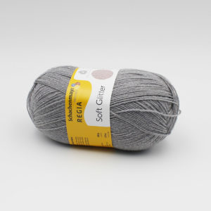 A ball of Regia's Soft Glitter in the Light Grey colorway