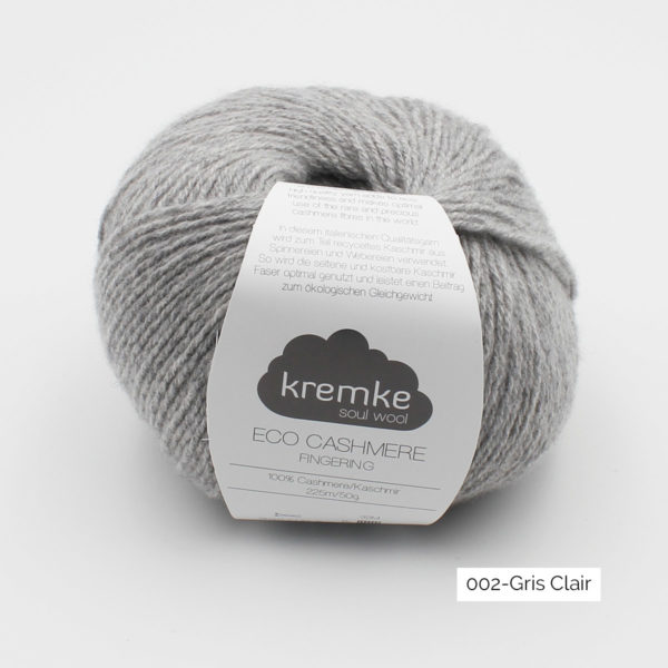 A ball of Kremke's Eco-Cashmere in the Gris Clair colorway (light grey)