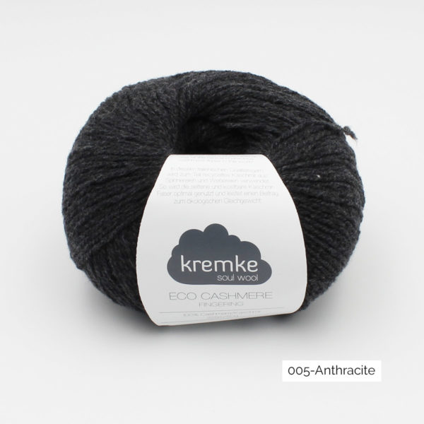 A ball of Kremke's Eco-Cashmere in the Anthracite colorway (dark grey)