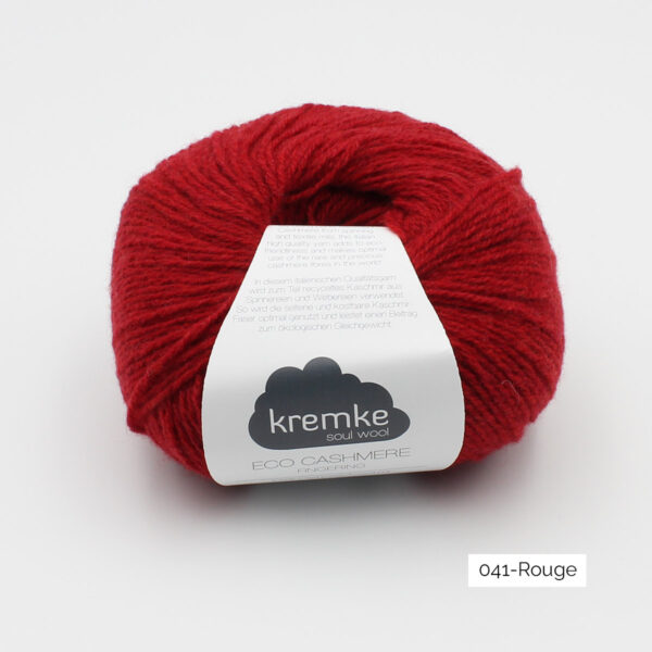 A ball of Kremke's Eco-Cashmere in the Rouge colorway (bright red)