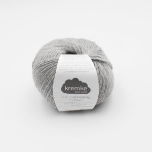 A ball of Kremke's Eco-Cashmere in the Light Grey colorway