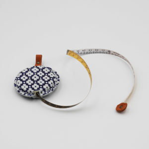 Display of Cohana's Yuzen leather tape measure, in blue with white flowers