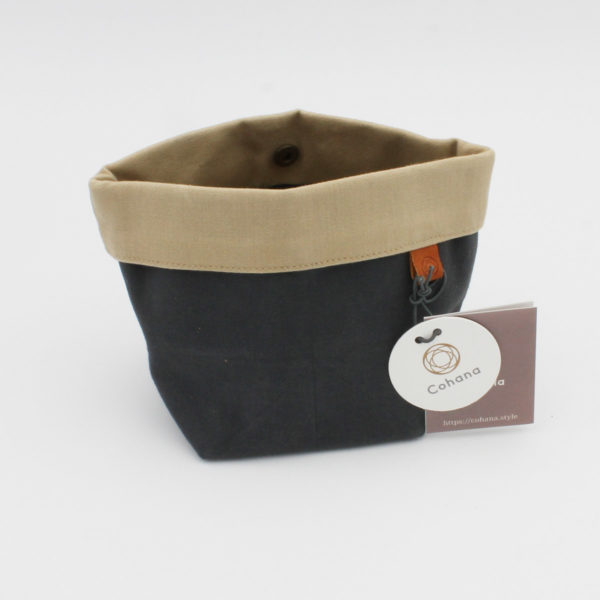 Display of Cohana's small notions pouch made of waxed canvas, in the charcoal and beige colorway
