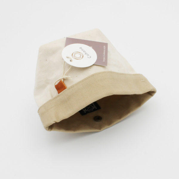 Display of Cohana's small notions pouch made of waxed canvas, in the natural and beige colorway