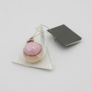 Cohana's mini pin cushion, made of cypress wood and banshu pink fabric, in its packaging